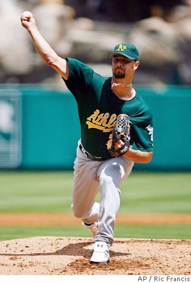 Oakland Athletics pitcher Esteban Loaiza throws against the Los Angeles Angels during a baseball game Wednesday, Aug. 2, 2006, in Anaheim, Calif. (AP Photo/Ric Francis) Photo: RIC FRANCIS