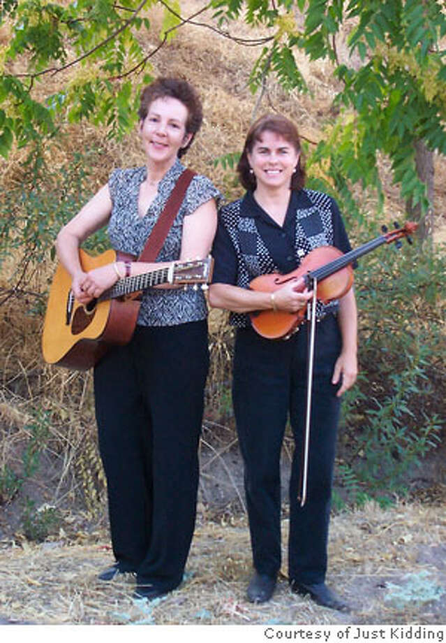 Lynn Quinones - LEFT - guitar and Jill Cruey - RIGHT - fiddle comprise Just Kidding, a bluegrass band for kids. Credit: Courtesy Just Kidding Photo: Courtesy Just Kidding