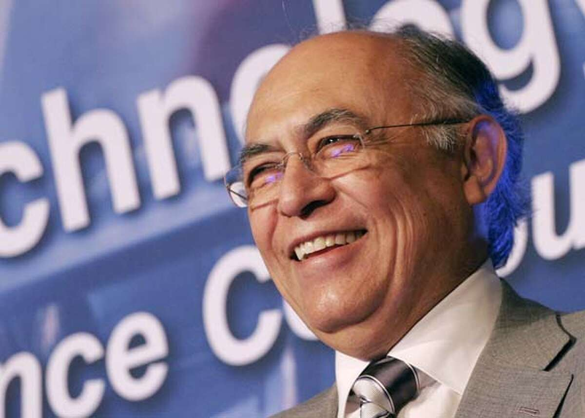 Hector Ruiz, chairman and CEO of Advanced Micro Devices, Inc., smiles during a joint news conference with International Business Machines Corp. on Tuesday, Aug. 1, 2006 in New York. AMD and IBM announced that IBM is extending its line of AMD Opteron processor-based servers. (AP Photo/Mark Lennihan)