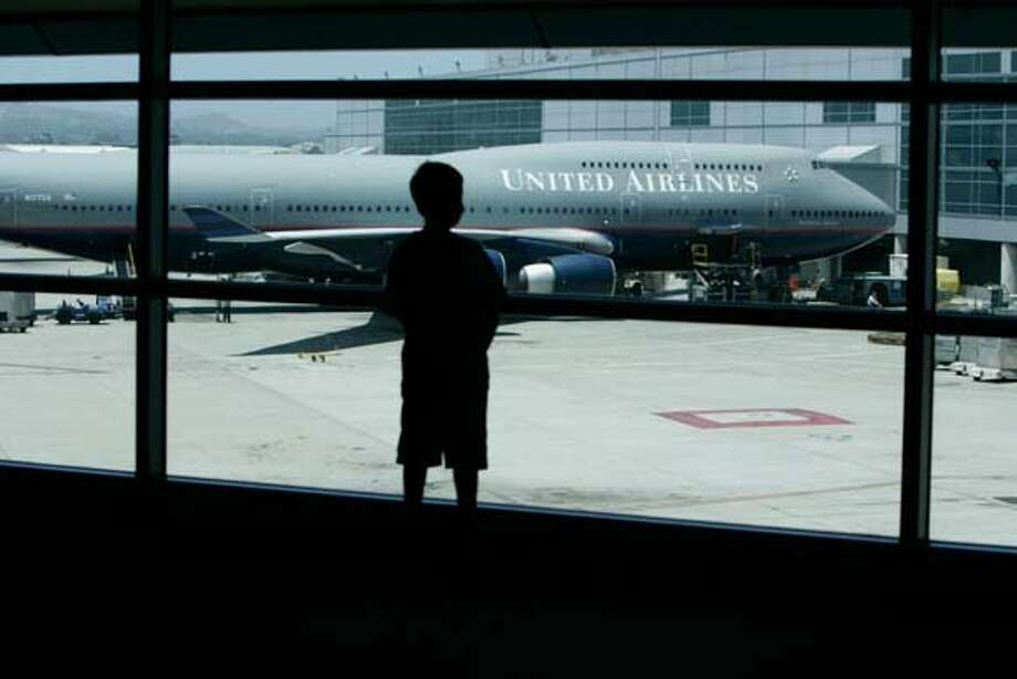 United Airlines is one of the U.S. carriers that is going to have to make some changes in order to compete with foreign airlines carriers for the high paying business travelers on international flights , at San Francisco International Airport, Tuesday June 20,2006 (Lacy Atkins/The Chronicle) MANDATORY CREDITFOR PHOTGRAPHER AND SAN FRANCISCO CHRONICLE/ -MAGS OUT Photo: Lacy Atkins