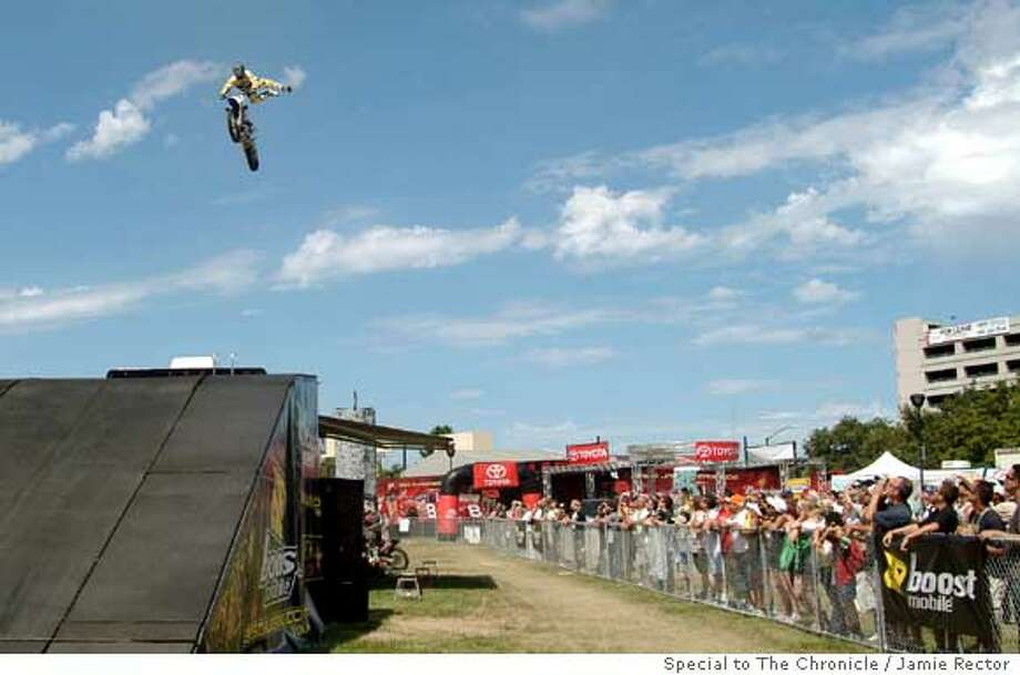 July 30, 2006- Clifford Adopante, a freestyle motorcross rider, demonstrates some stunt moves for people in the Discovery Meadow area of the San Jose Grand Prix. The Grand Prix raced it's way through town for it's second year in a row, offering guests the opportunity to watch the racing as well as watching freestyle motorcross demos, various exhibit cars, music, as well as enjoy food and sunshine. Photo By: Jamie Rector  Ran on: 07-31-2006  Go-carts have their day as a side event at the Grand Prix of San Jose, offering spectators the chance to do a little racing of their own.  Ran on: 07-31-2006  Go-carts have their day as a side event at the Grand Prix of San Jose, offering spectators the chance to do a little racing of their own. Photo: Jamie Rector
