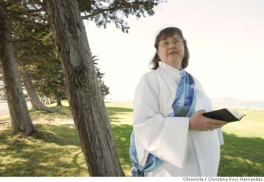 Kathleen Kunster , wearing an alb and stole, often prays at this Emeryville park, overlooking the Bay. Kathleen Kunster, an East Bay woman who will be joining 11 other women from around the country on July 31 to be ordained as Roman Catholic priests and deacons. This action is not approved by the church hierarchy, the women are risking possible excommunication, but they say they feel called to minister in this fashion.Kunster, 61, has wanted to be a priest her whole life. She holds a master's degree in divinity, has done parish ministry, has completed coursework as a psychologist. Kunster lives in Emeryville. She often prays at a park near her home (CHRISTINA KOCI HERNANDEZ/THE CHRONICLE) Mandatory Credit For Photographer and San Francisco Chronicle/No-Sales-Mags Out Photo: Christina Koci Hernandez