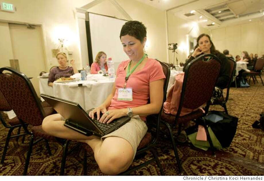 During the lunchtime BlogHer speakers presentation, Danielle Altshuler Wiley, surfs the internet on her laptop.At the BlogHer convention in San Jose, a gathering billed as a meeting place for female bloggers, advertisers are now present, from Weight Watchers to Saturn.(CHRISTINA KOCI HERNANDEZ/THE CHRONICLE) Mandatory Credit For Photographer and San Francisco Chronicle/No-Sales-Mags Out Photo: Christina Koci Hernandez