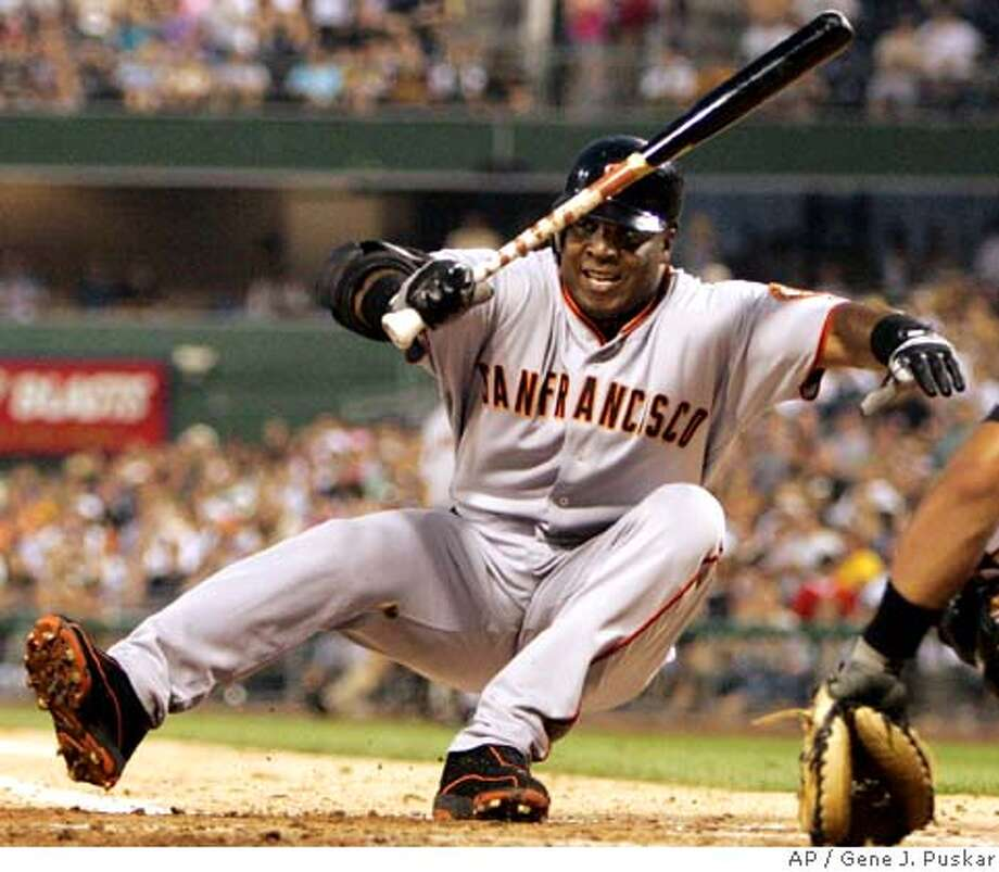 San Francisco Giants' Barry Bonds hits the dirt after fouling a ball off his foot during a sixth-inning at-bat against Pittsburgh Pirates starting pitcher Tom Gorzelanny in baseball action Saturday, July 29, 2006, at Pittsburgh. Bonds took a called third strike.(AP Photo/Gene J. Puskar) Photo: GENE J. PUSKAR