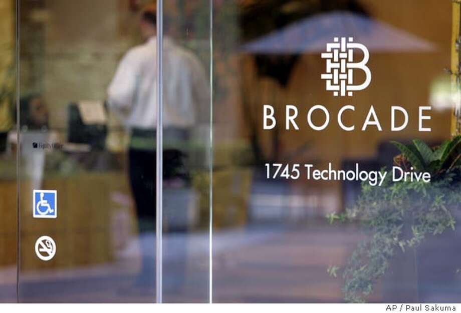 Exterior view of Brocade Communications Systems Inc. headquarters in San Jose, Calif., Thursday, July 20, 2006. The former chief executive of Brocade was charged Thursday with fraud, the first criminal complaint in a stock options probe that involves more than 55 U.S. companies. Gregory L. Reyes, 43, became the first chief executive to be charged criminally for improper practices related to the accounting of stock options grants. (AP Photo/Paul Sakuma) Photo: PAUL SAKUMA