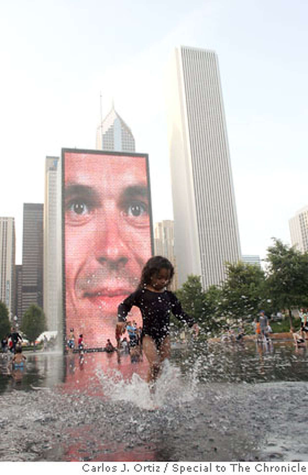 Crown Fountain At the southwest corner of the park (Michigan Avenue and Monroe Street) are twin 50-foot fountain towers. In addition to the cascading water, the towers display video images of various Chicagoans and lights. On warm summer days, children (as well as youthful- spirited adults) frolic in the shallow water between the two towers and delight in the spray from the fountains. The surrounding green area is a relaxing place to spread out on a blanket and read a book. Ran on: 07-30-2006