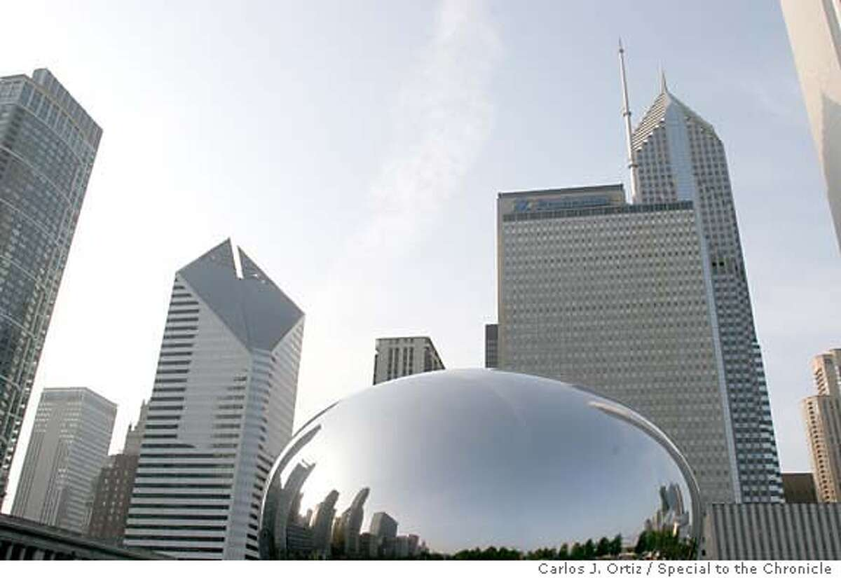 Shiny bean: Anish Kapoor's sculpture in Chicago's Millennium Park presents a stunning skyline reflection. Photo by Carlos J. Ortiz, special to the Chronicle