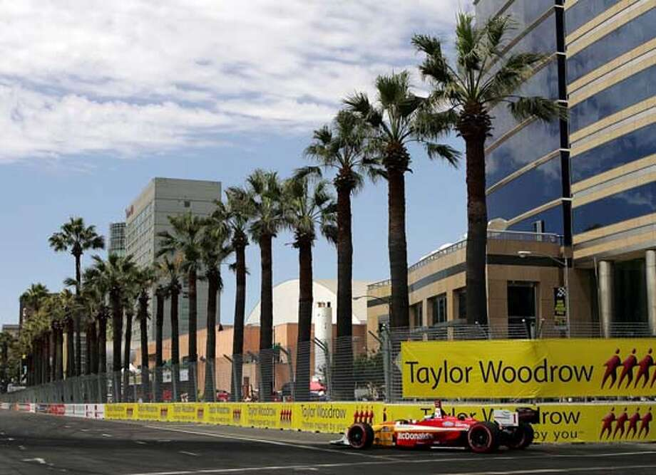 Champ car driver Sebastien Bourdais, of France, turns on Almaden Blvd. en route to capturing the pole position for the San Jose Grand Prix in San Jose, Calif. on Saturday, July 29, 2006. (AP Photo/Marcio Jose Sanchez) Photo: MARCIO JOSE SANCHEZ