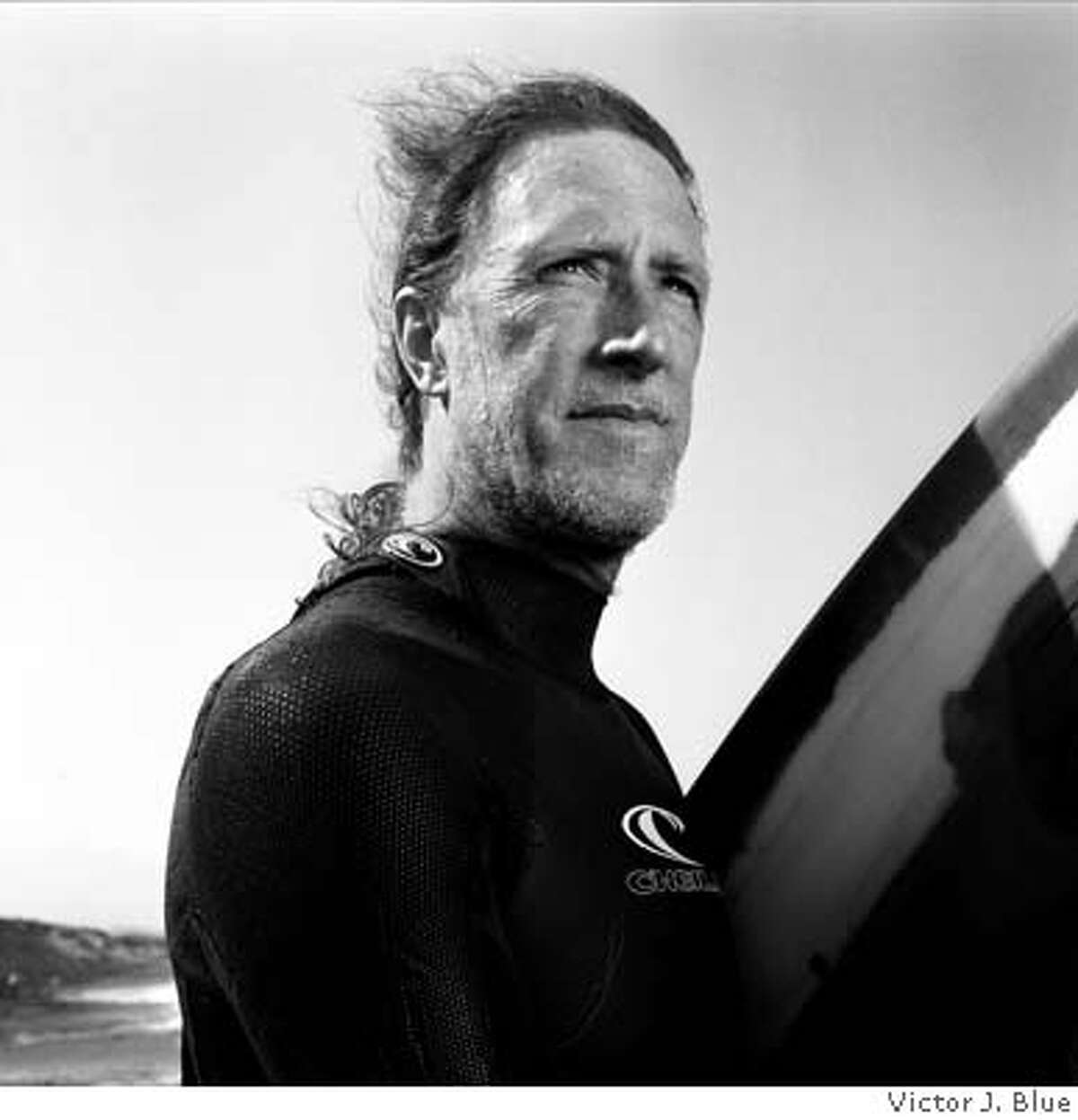 Surfer Mark Renneker at Ocean Beach in San Francisco. Photo by Victor J. Blue