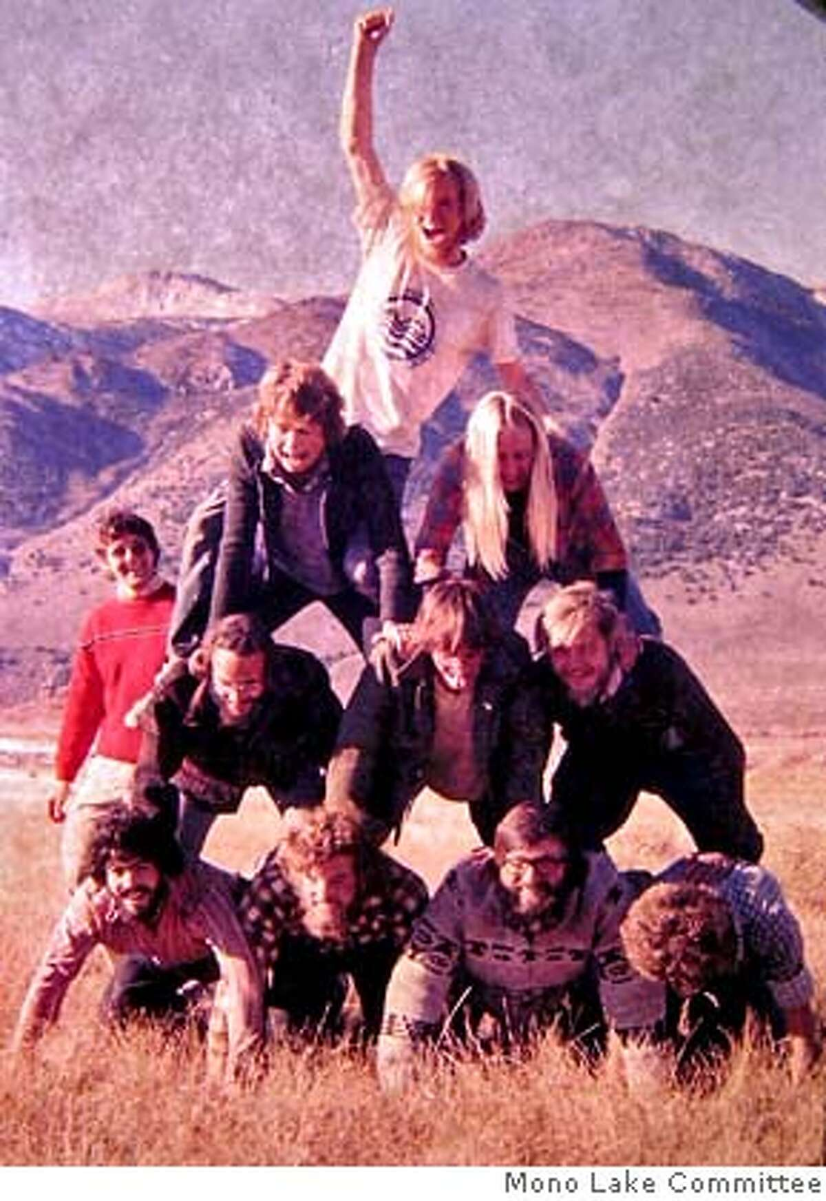 1976 Mono Lake - Thirty years ago, a group of college student researchers preserved their images at a Mono Lake campsite. At the top is Elliot Burch. Second row, left to right, are Christine Weigen and Gayle Dana, Third Row, Tom Wainwright, visitor Bill Syme and Brett Engstrom. Bottom row, Bob Loeffler, Jefferson Burch, David Winkler and David Herbst. Jeff Robins is standing at left. Photo Credit: David Gaines