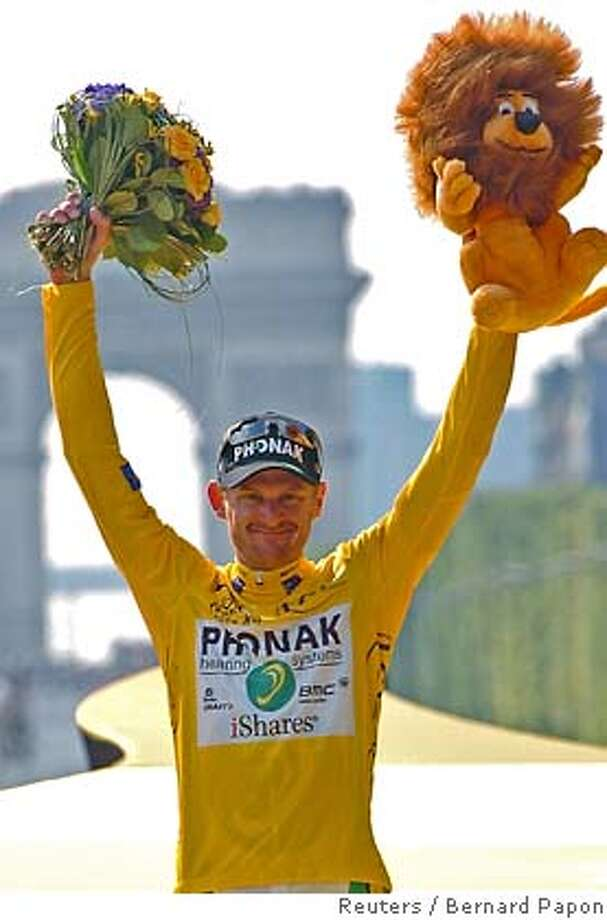 File photo of Phonak's team rider Floyd Landis of the U.S. celebrating his overall victory on the podium after winning the 93rd Tour de France cycling race in Paris Photo: POOL