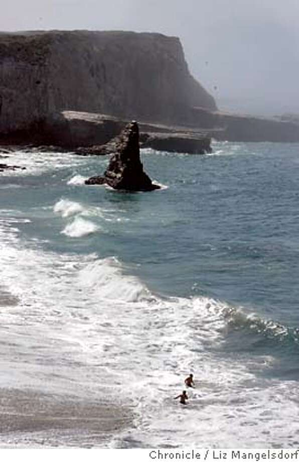coastdairies_lm193.JPG  Two men play in the surf on Davenport Beach, which is part of the land that The Trust for Public Land is turning over to the state. The land, known as the Coast Dairies Ranch, is a 5-mile stretch of beachfront property along Highway 1 north of Santa Cruz that surrounds the small town of Davenport, CA. Photos taken on Monday, July 24th. Liz Mangelsdorf /The Chronicle MANDATORY CREDIT FOR PHOTOG AND SF CHRONICLE/ -MAGS OUT Photo: Liz Mangelsdorf