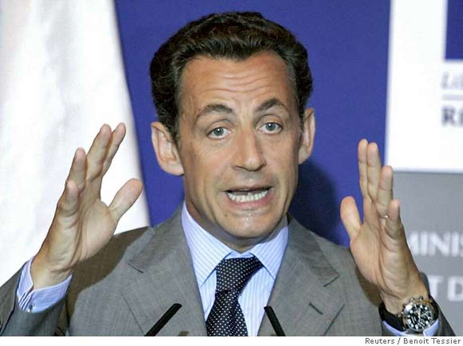 France's Interior Minister Nicolas Sarkozy addresses a press conference on immigration in Paris Photo: BENOIT TESSIER