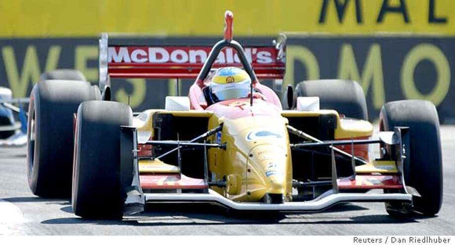 CHAMP car driver Sebastien Bourdais of France races to a second place finish at the Grand Prix of Edmonton in Edmonton July 23, 2006. REUTERS/Dan Riedlhuber (CANADA) 0 Photo: DAN RIEDLHUBER
