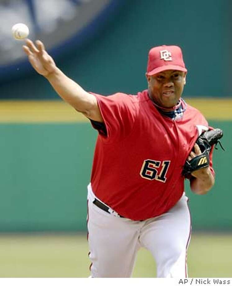 Washington Nationals starter Livan Hernandez delivers a pitch against the San Francisco Giants during a baseball game, Thursday, July 27, 2006, in Washington.(AP Photo/Nick Wass) EFE OUT Photo: NICK WASS
