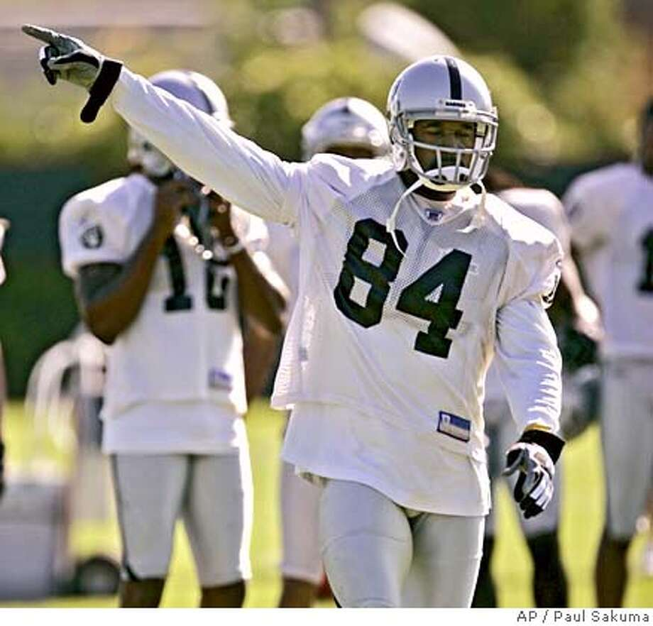 Oakland Raiders wide receiver Jerry Porter points during the Raiders training camp in Napa, Calif., Tuesday, July 25, 2006 in preparation for the upcoming NFL football season. (AP Photo/Paul Sakuma) Photo: PAUL SAKUMA