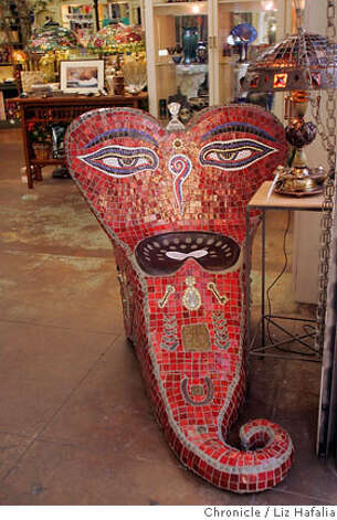 STREETDATE27_084.JPG Mosaic art (front) by Tina Amidon, an artist who also teaches a mosaic birdbath workshop at Stained Glass Garden. Streetdate feature for 96 Hours on Fourth Street, Berkeley.  Liz Hafalia/The Chronicle  Ran on: 07-27-2006  Mosaic art, above, and workshops are avail- able at Stained Glass Garden, while Stone- house California Olive Oil, managed by Stacy Roach, left, offers a tasting table. Photo: Liz Hafalia