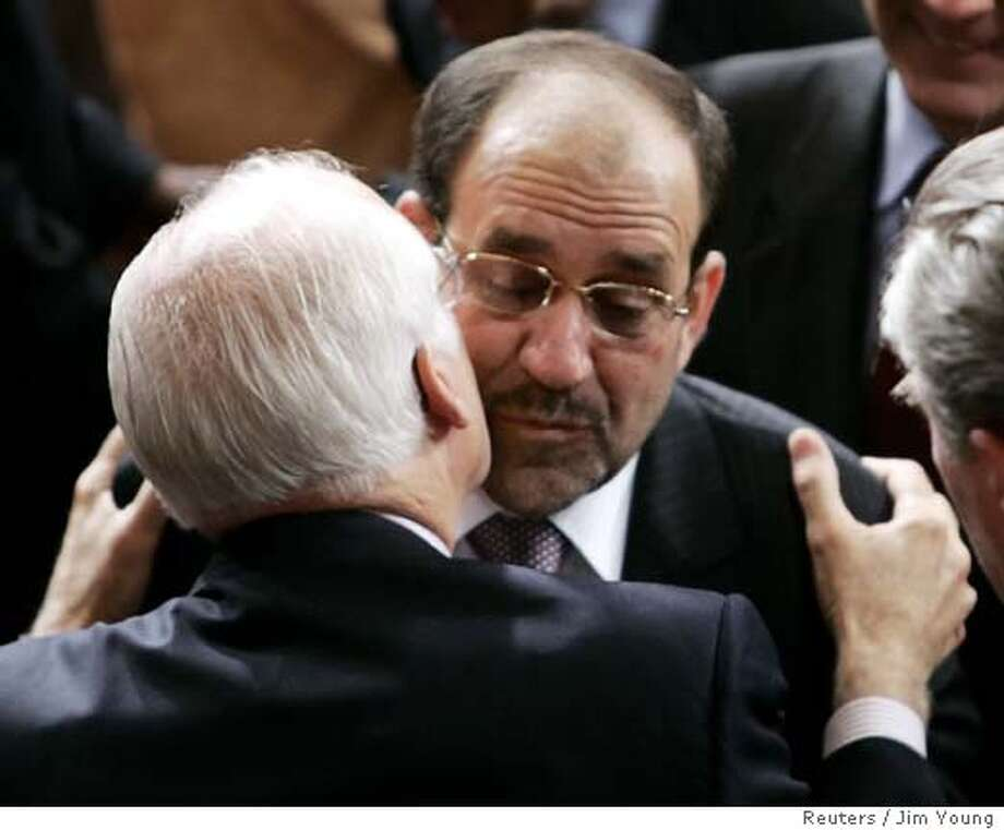 US Rep Shays kisses Iraqi Prime Minister al-Malik after a speech to a joint meeting of Congress in Washington Photo: JIM YOUNG