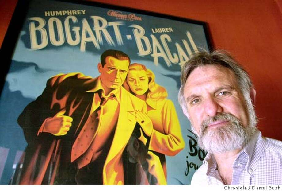 "�neighbor084_db.jpg Gary Meyer, owner of Balboa Theater, next to a movie poster of the movie ""Dark Passage,"" that hangs in the lobby of the Balboa Theater on Balboa St. in the outer Richmond. 8/21/03 in San Francisco. DARRYL BUSH / The Chronicle MANDATORY CREDIT FOR PHOTOG AND SF CHRONICLE/ -MAGS OUT"