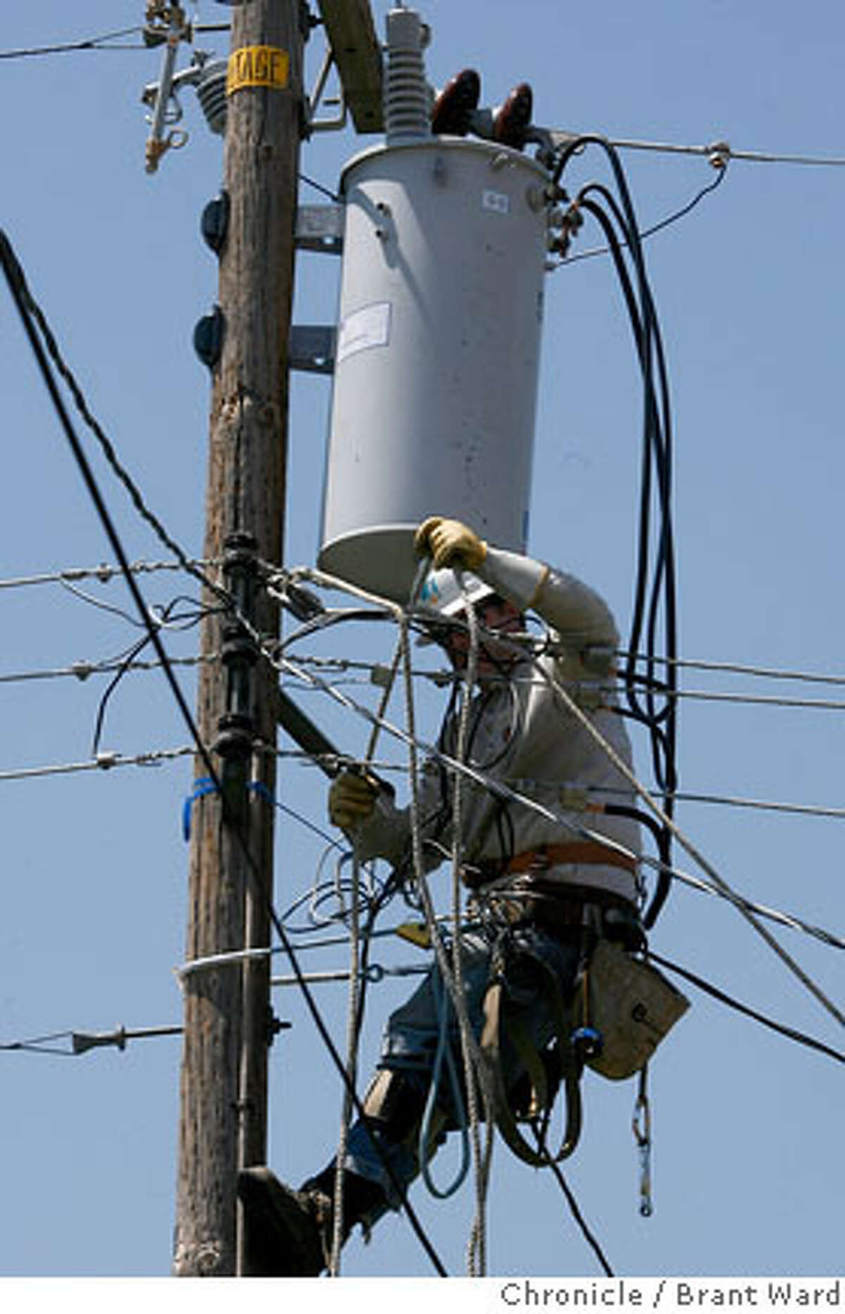 PG&E workers replaced a transformer that blew up just off Hill Park Drive in San Jose...this site has had several transformer malfunctions since the weekend. In South San Jose, hundreds of people are still without power. Many lost their power over the weekend when temperatures were in the 100s. PG&E crews from around the Bay Area are busy replacing blown transformers which couldn't take the prolonged heat. {Brant Ward/The Chronicle} 7/25/06