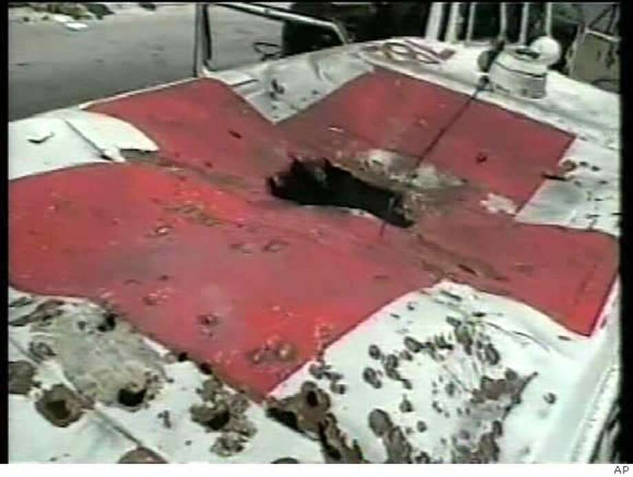 This image taken from video made by Lebanese Red Cross workers Sunday, July 23, 2006 in Qana, south Lebanon, and made available to AP Television, shows the roof of a Lebanese Red Cross ambulance destroyed in what they say was an Israeli airstrike. The Red Cross workers who provided AP Television News with the video said that nine ambulance workers were wounded in the explosion as they tried to ferry injured people from the town of Qana, 20 kilometers (about 12 and a half miles) from Tyre, to hospital. AP Television cannot independently verify whether the Red Cross workers were hit by an Israeli airstrike. (AP Photo) Photo: HO
