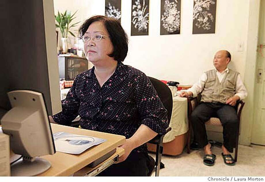 chinatown001384_lm.jpg Ru Mei Peng (left) and Jian Guang Ji spend an afternoon in their apartment in the Fong Building in San Francisco, CA. Peng and Ji have lived in the building for 11 years and will soon be owners when the building becomes San Francisco's first community land trust. Laura Morton/The Chronicle Photo: Laura Morton