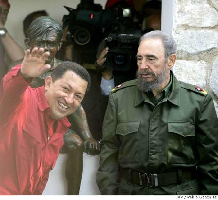 Hugo Chavez, Fidel Castro Photo: PABLO GONZALEZ
