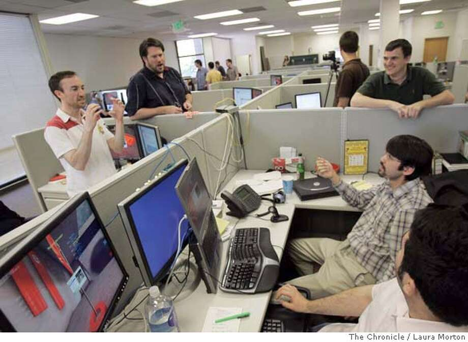 "gamers2760_lkm.jpg At JotSpot's office in Palo Alto, employees chat after a round of ""UnReal Tournament,"" the video game they play against each other once a week. Laura Morton/The Chronicle MANDATORY CREDIT FOR PHOTOGRAPHER AND SAN FRANCISCO CHRONICLE/ -MAGS OUT Photo: Laura Morton"