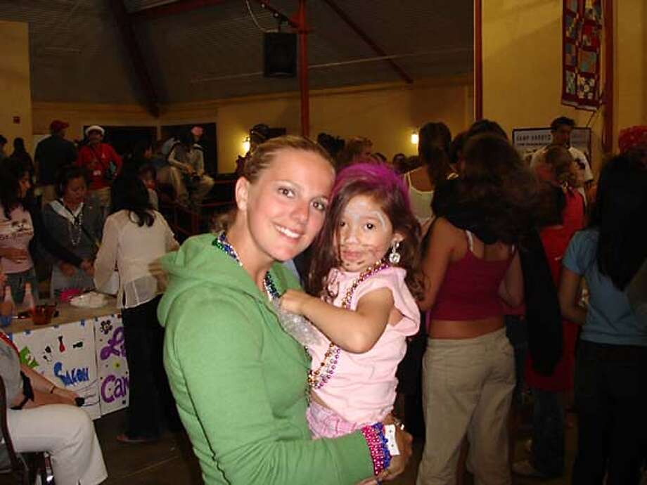 Francesca Tenconi holds Clair, one of the children attending Camp Wonder in Livermore, at dress-up night earlier this summer, 2006. Credit: Children's Skin Disease Foundation Photo: Children's Skin Disease Foundati