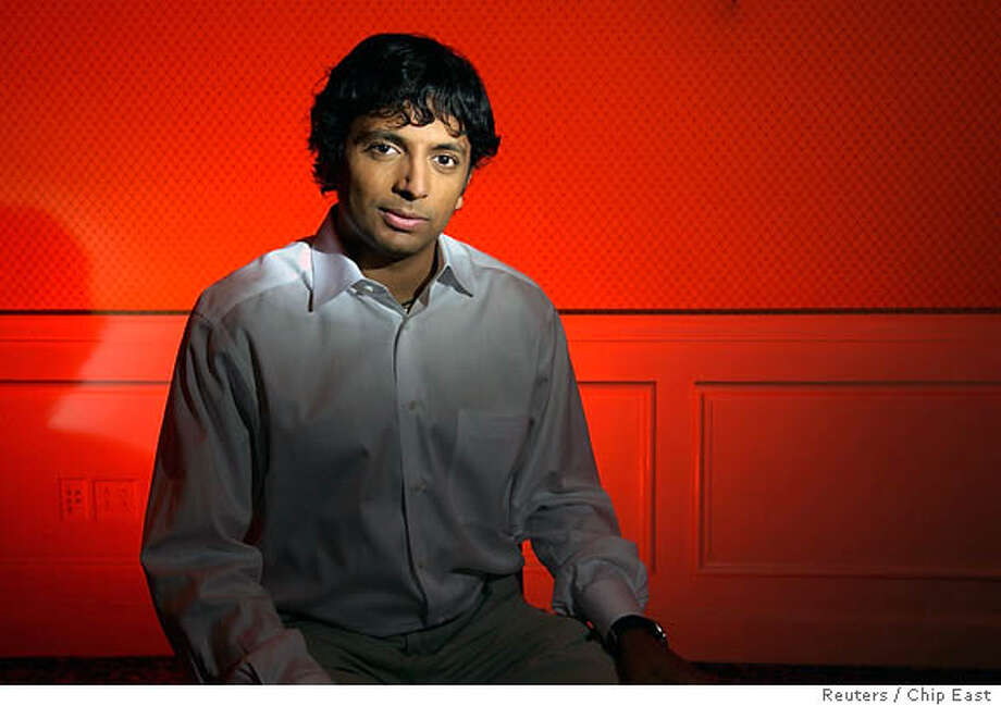 """Film director M. Night Shyamalan poses in New York July 8, 2006. Shyamalan's new film """"Lady in the Water"""" opens nationwide July 21. REUTERS/Chip East (UNITED STATES) 0 Photo: CHIP EAST"""
