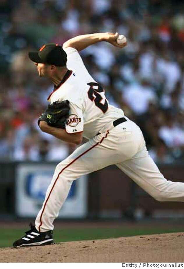 Giants_01_JMM.JPG  San Francisco's Jason Schmidt pitches the ball during the first inning at AT&T Ball Park in San Francisco.  Event on 7/22/06 in San Francisco. JAKUB MOSUR / The Chronicle MANDATORY CREDIT FOR PHOTOG AND SF CHRONICLE/ -MAGS OUT Photo: JAKUB MOSUR