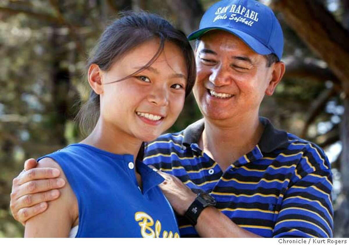 Allen Ng and his Daughter Allison. Allison who was adopted from China has been invited to go back to China along with other adoptees by the Chinese Government. For an all expenses paid trip to maintain ties to their home land. Allen and Allison were photographed between softball games In Vallejo. KURT ROGERS/THE CHRONICLE VALLEJO THE CHRONICLE SFC CHINAADOPTXX_0122_kr.jpg MANDATORY CREDIT FOR PHOTOG AND SF CHRONICLE / -MAGS OUT