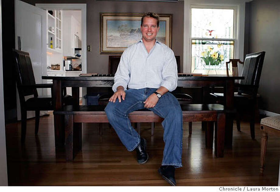 Secondhome236947_lkm.jpg Chris Hawkins poses in the dining room of his Marina condominium on Sunday, July 16, 2006. Hawkins lived in a smaller unit in the same building and was able to buy the condo he now lives in as well as keep the smaller one, which he now rents. Laura Morton/The Chronicle MANDATORY CREDIT FOR PHOTOGRAPHER AND SAN FRANCISCO CHRONICLE/ -MAGS OUT Photo: Laura Morton