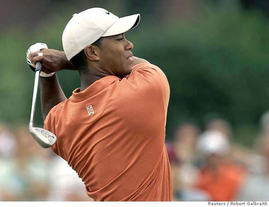 Tiger Woods of the U.S. hits from the 4th fairway during the third round of the British Open Championship at the Royal Liverpool Golf Club in Hoylake July 22, 2006. REUTERS/Robert Galbraith (BRITAIN) 0 Photo: ROBERT GALBRAITH