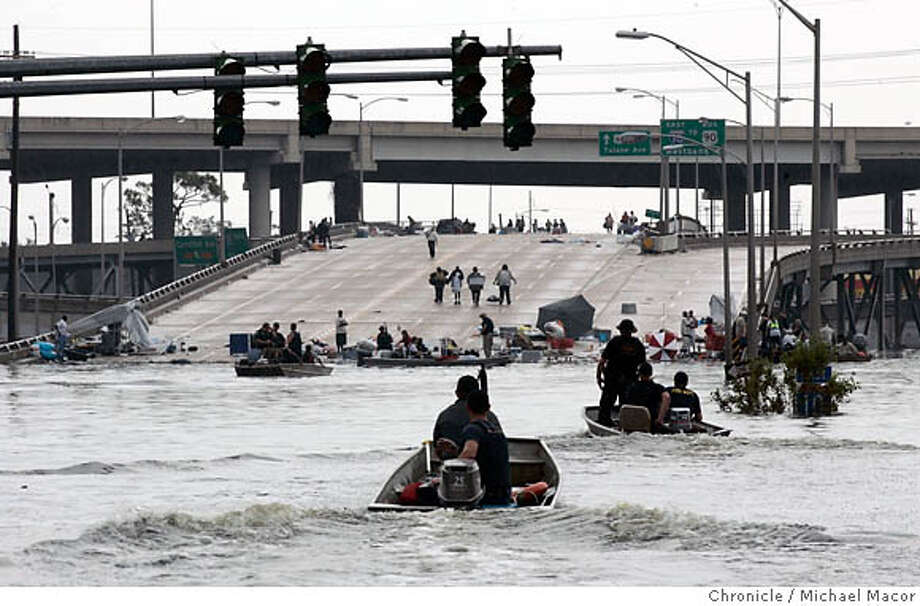 katrina_157_mac.jpg People stranded at the Airline Highway at I-10 Freeways, in Orleans Parrish, are finally reached by armed rescue boats, spending the last 4 days trapped inside their homes or on the roofs of their houses. The aftermath of Hurricane Katrina that ravaged the gulf coast states, hitting hard in New Orleans, Louisiana. 9/1/05 New Orleans , La Michael Macor / San Francisco Chronicle DO NOT RELEASE THIS PHOTO, SOLD EXCLUSIVELY TO GQ MAGAZINE, DOMESTIC, UNTIL 1/1/2006 gary fong. Ran on: 09-02-2005  Below, Natasha James (left) huddles with her friend Sharita Brown as Brown tries in vain to reach her mother in California by cell phone. They had been waiting to be rescued from an overpass since Tuesday. Ran on: 09-02-2005  Below, Natasha James (left) huddles with her friend Sharita Brown as Brown tries in vain to reach her mother in California by cell phone. They had been waiting to be rescued from an overpass since Tuesday. Ran on: 09-02-2005  Below, Natasha James (left) huddles with her friend Sharita Brown as Brown tries in vain to reach her mother in California by cell phone. They had been waiting to be rescued from an overpass since Tuesday. Mandatory Credit for Photographer and San Francisco Chronicle/ - Magazine Out Photo: Michael Macor