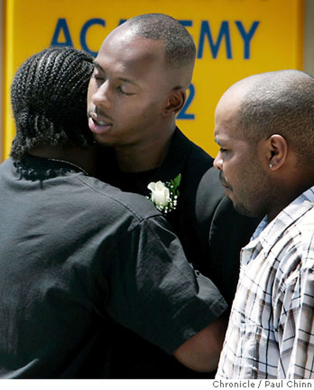 Prentice Walker (center) is consoled after the funeral service for his brother Carlnell Walker in Richmond, Calif. on Friday, July 21, 2006, who was found dead in the trunk of a car last week in Riverdale, Georgia. Three suspects have been arrested and a fourth is being sought for killing Carlnell Walker, who was a student at Morehouse College in Atlanta. PAUL CHINN/The Chronicle **Carlnell Walker, Prentice Walker