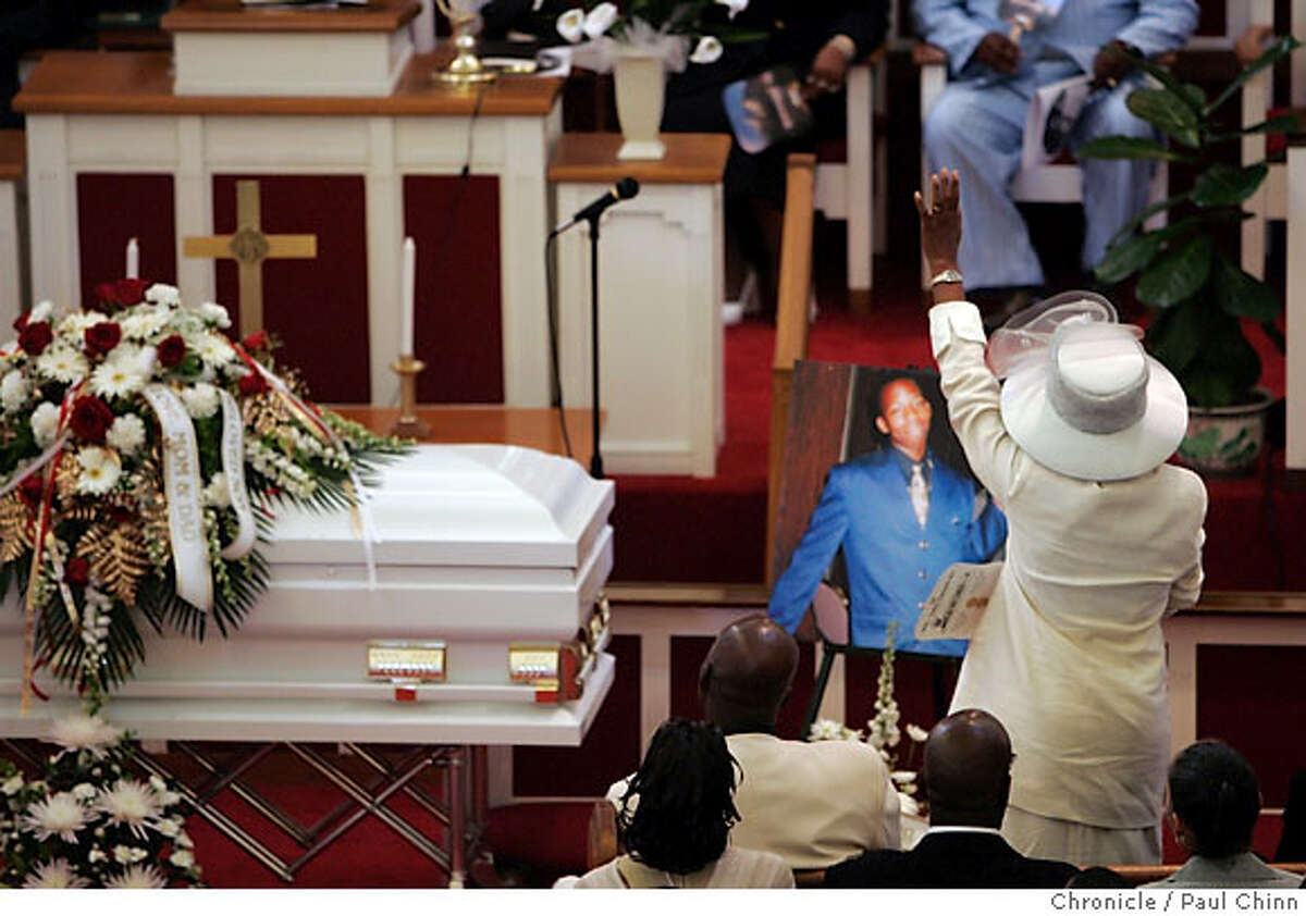 Peggy Walker rises to her feet during the funeral for her son, Carlnell J. Walker, in Richmond, Calif. on Friday, July 21, 2006, who was found dead in the trunk of a car last week in Riverdale, Georgia. Three suspects have been arrested and a fourth is being sought for killing Walker, who was a student at Morehouse College in Atlanta. PAUL CHINN/The Chronicle **Carlnell Walker, Peggy Walker