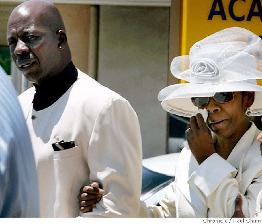 Carl and Peggy Walker leave the funeral service for their son Carlnell in Richmond, Calif. on Friday, July 21, 2006, who was found dead in the trunk of a car last week in Riverdale, Georgia. Three suspects have been arrested and a fourth is being sought for killing Carlnell Walker, who was a student at Morehouse College in Atlanta.  PAUL CHINN/The Chronicle  **Carlnell Walker, Carl Walker, Peggy Walker; *Carl and Peggy are divorced. Photo: PAUL CHINN