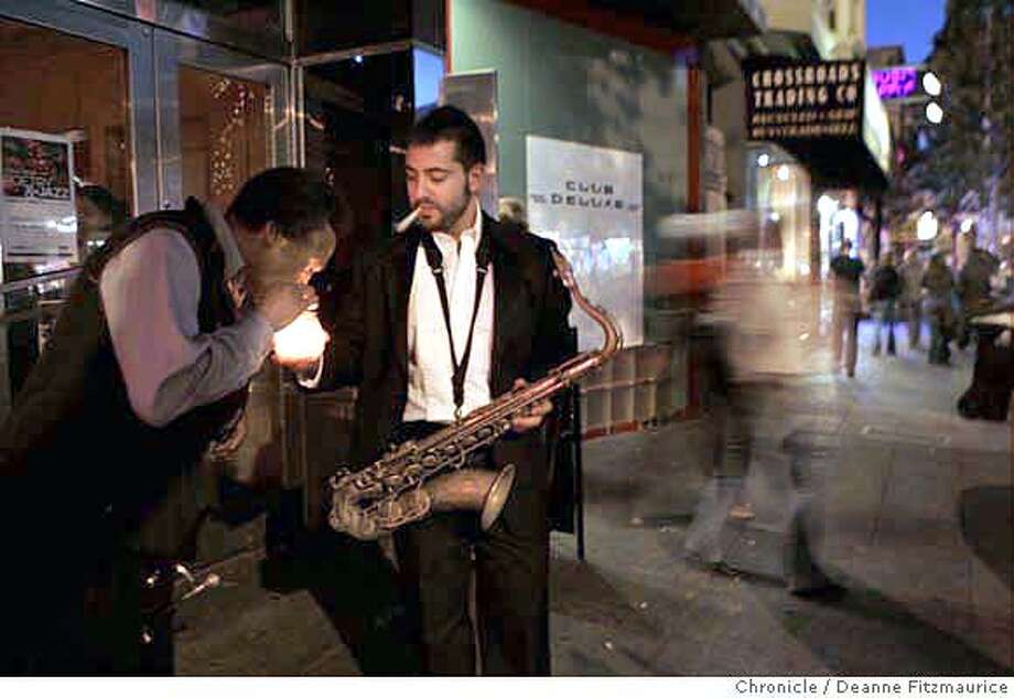 deluxe22_289_df.jpg  Saxophone player Daniel Heffez brought a candle from inside to light a cigarette for trumpet player Thatcher Baker, at left, as they take a cigarette break outside. Poets, jazz musicians and fans of both came to Club Deluxe on Haight Street for the first anniversary of Poetry and Jazz Night. Photographed in San Francisco on 7/18/06.  (Deanne Fitzmaurice/ The Chronicle) Daniel Heffez  Thatcher Baker Mandatory credit for photographer and San Francisco Chronicle. /Magazines out. Photo: Deanne Fitzmaurice