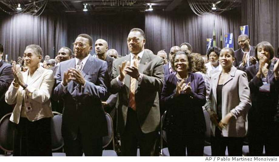 The Rev. Jesse Jackson, center, joins in applauding during President Bush's speech at the National Association for the Advancement of Colored People Convention, Thursday, July 20, 2006 in Washington. President Bush acknowledged persistent racism in America and lamented the Republican Party's bumpy relations with black voters as he addressed the NAACP's annual convention Thursday for the first time in his presidency. (AP Photo/Pablo Martinez Monsivais) Photo: PABLO MARTINEZ MONSIVAIS