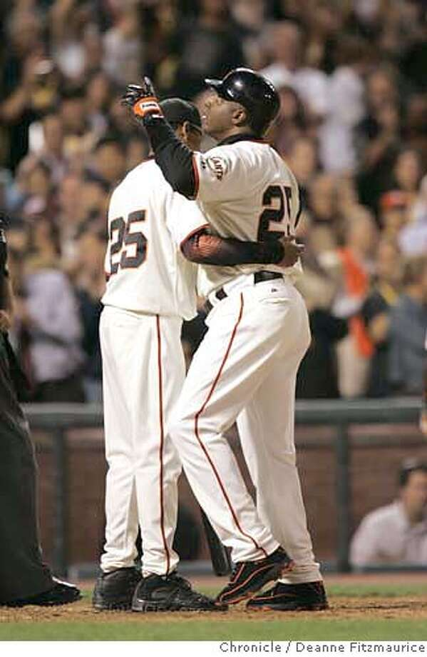 Barry Bonds hugs his son Nickolai after he hits homerun #722 which was the first of three back to back homeruns by the Giants in the 8th inning. San Francisco Giants vs the San Diego Padres at AT&T Park. Photographed in San Francisco on 7/20/06.  (Deanne Fitzmaurice/ The Chronicle) Photo: Deanne Fitzmaurice
