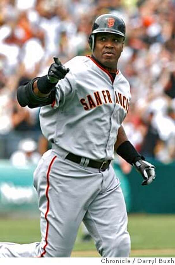 ATHLETICS21_0186_db.JPG  San Francisco Giants Barry Bonds points to the crowd after hitting his 714th career home, tying Babe Ruth's record in the 2nd inning of the San Francisco Giants vs. Oakland Athletics game, at McAfee Coliseum in Oakland, CA on Saturday, May, 20, 2006. shot: 5/20/06  Darryl Bush / The Chronicle ** Barry Bonds (roster)  Ran on: 05-21-2006  Barry Bonds points toward the crowd after hitting career home run No. 714 Saturday. He had been without a homer since May 7 but found the right field fence off A's left-hander Brad Halsey. Full coverage in Sports.  Ran on: 05-21-2006 MANDATORY CREDIT FOR PHOTOG AND SF CHRONICLE/ -MAGS OUT Photo: Darryl Bush