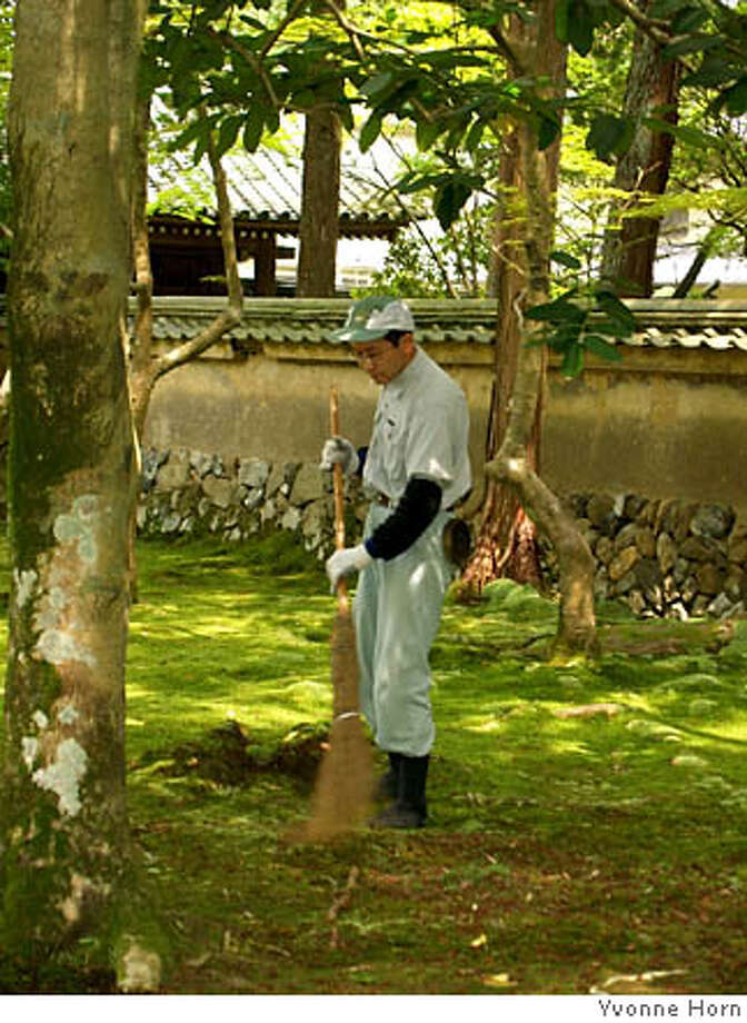 Kyoto Koke-dera (Moss Garden) Caretakers sweep carpet of green Photo: Yvonne Horn