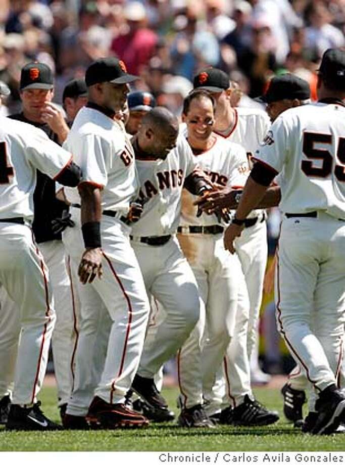 GIANTS20_004_CAG.JPG  Giants' Ray Durham, center, is mobbed by teammates after hitting a two-run single in the bottom of the ninth inning to win the game. The San Francisco Giants played the Milwaukee Brewers at AT&T Park in San Francisco, Ca., on Wednesday, July 19, 2006, winning 7-6.  Photo by Carlos Avila Gonzalez/The San Francisco Chronicle  Photo taken on 7/19/06, in San Francisco, Ca, USA  **All names cq (Roster) MANDATORY CREDIT FOR PHOTOG AND SAN FRANCISCO CHRONICLE/ -MAGS OUT Photo: Carlos Avila Gonzalez