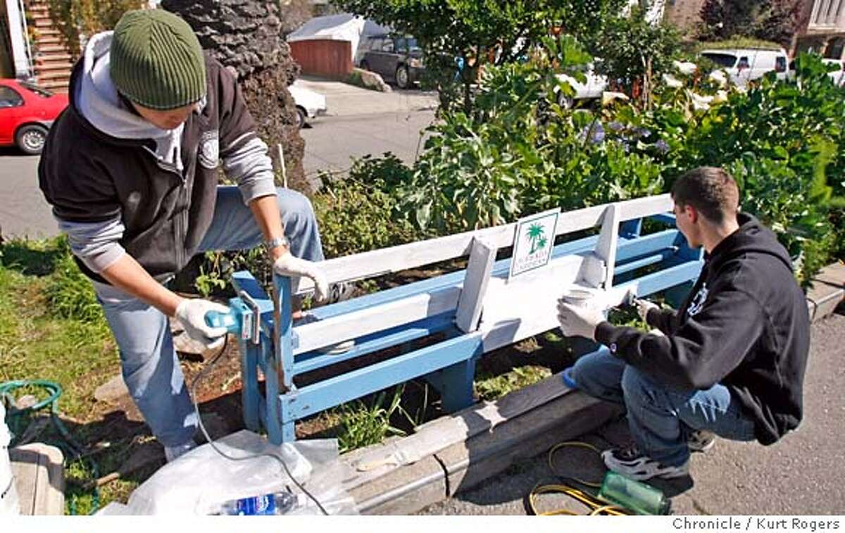 John lee and Jon Zemel work on restoring a bench that was run over by a car. Students from Stanford university helped work on a community garden along the median strip on Quesada st in San Francisco where the residence have made the garden. Kurt Rogers San Francisco SFC The Chronicle QUESADA_00005_kr.JPG MANDATORY CREDIT FOR PHOTOG AND SF CHRONICLE/ -MAGS OUT