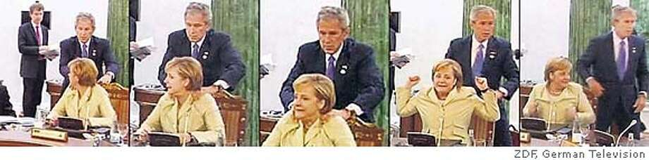 Video framegrab of President George W. Bush giving impromptu neck massage to German Chancellor Angela Merkel at the G8 Summit in St. Petersburg, Russia. Released July 18, 2006. Photo Credit: ZDF, German Television.