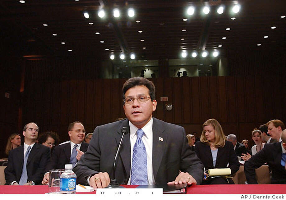 Attorney General Alberto Gonzales prepares to testify before the Senate Judiciary Committee in Washington Tuesday, July 18, 2006, during a hearing on Justice Department oversight. (AP Photo/Dennis Cook) Photo: DENNIS COOK