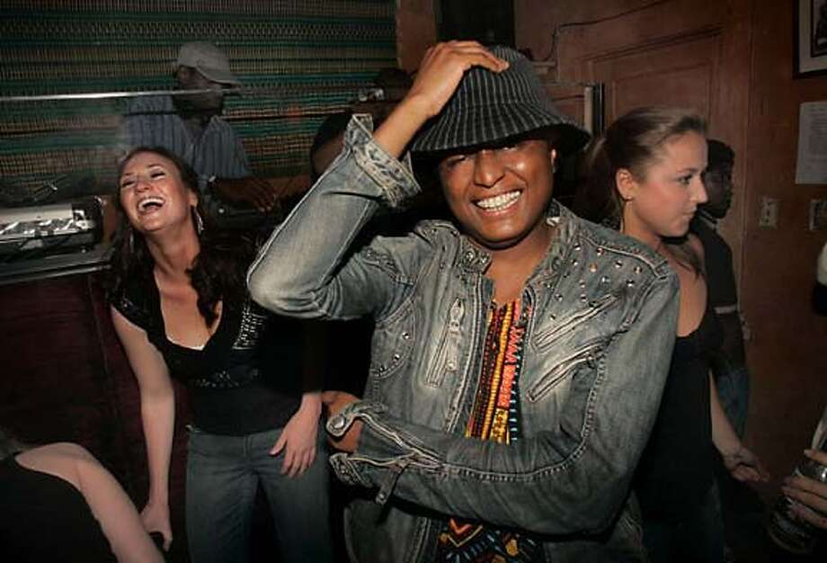 "ONTHETOWN_SILA_047.JPG Victor Sila (front) in Little Baobab, a bar/dance club on 19th St. which he says is ""Dirty dancing set in the Sahara desert. Sorta."" At left is Aine Sands and at right is Grace Goelzer, both from San Francisco. Liz Hafalia/The Chronicle.  Ran on: 07-16-2006 Ran on: 07-16-2006  Victor Sila grooves with Aine Sands (left) and Grace Goelzer at Little Baobab, a bar-dance club in San Francisco. Photo: Liz Hafalia"