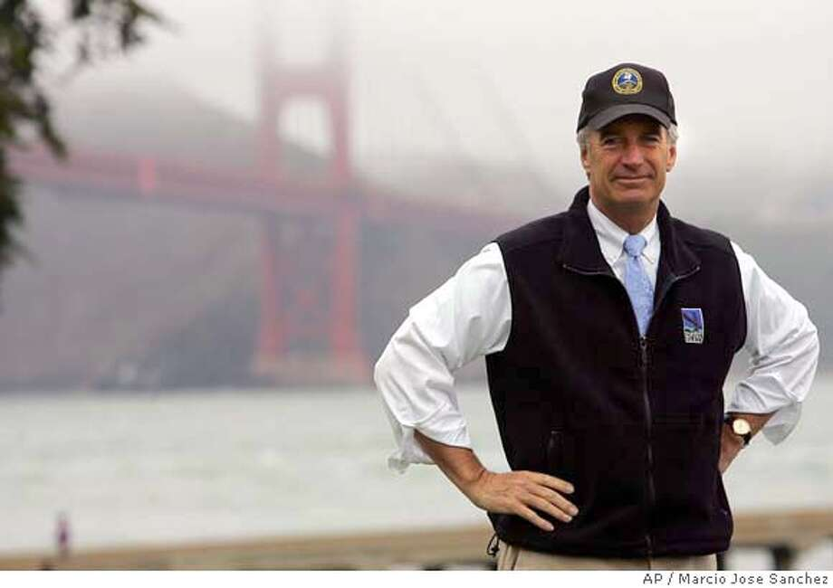 U.S. Interior Secretary Dirk Kempthorne stands in front of the Golden Gate Bridge during a visit to Golden Gate National Recreation Area in San Francisco on Friday, July 14, 2006. (AP Photo/Marcio Jose Sanchez) STAND ALONE PHOTO Photo: MARCIO JOSE SANCHEZ