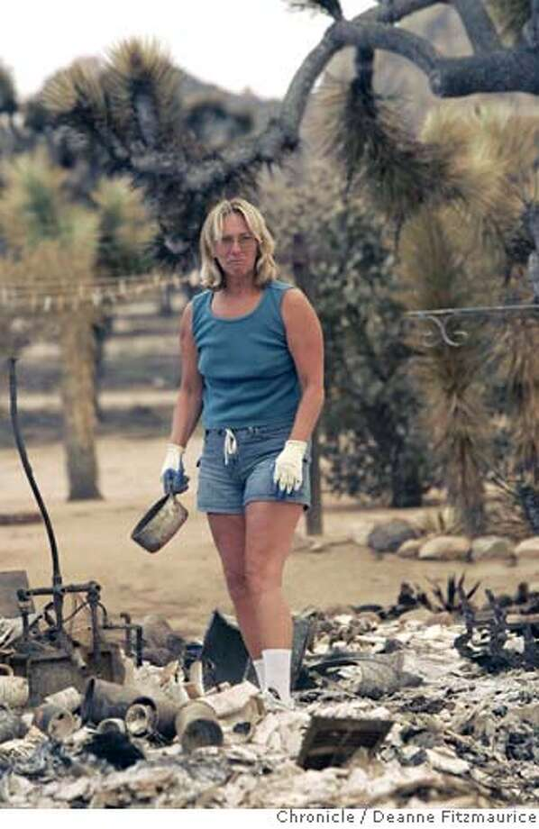 Joanne Kretschmer just returned home to Pioneertown to find that her and her husband, Fred's home of 23 years had burned to the ground. A fire is raging in San Bernadino County. Photographed in Pioneertown on 7/13/06.  (Deanne Fitzmaurice/ The Chronicle) Photo: Deanne Fitzmaurice